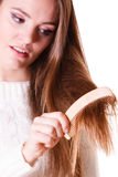 Woman combing and pulls hair. Dissatisfied woman combing with brush and pulls at her long hair. Being unhappy for nice look in daily activity Stock Photos