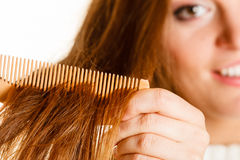 Woman combing and pulls hair. Stock Images