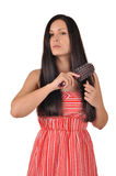 Woman combs her hair Stock Images