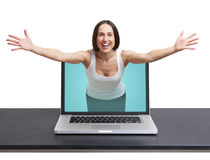 Woman come out from laptop Stock Image