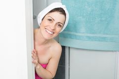 woman comes out of her shower with the towel on her hair stock photos