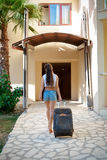 Woman comes with  suitcase Stock Image