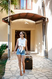 Woman comes with  suitcase Stock Photos