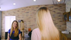 A woman comes to a beauty salon stock footage