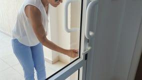 Woman open the door with keys