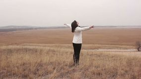 Woman comes to the ravine her arms in nature open stock video footage
