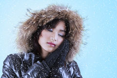 Woman with comfortable winter jacket Stock Photos