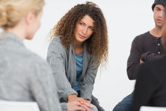 Woman comforting another in rehab group at therapy Stock Photos