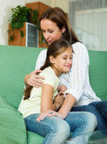 Woman comforting  daughter. At home Royalty Free Stock Images