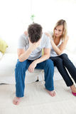 Woman comforting her boyfriend. In the living-room Royalty Free Stock Images