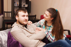 Woman comforting her husband. Young women comforting her husband at home Royalty Free Stock Photos
