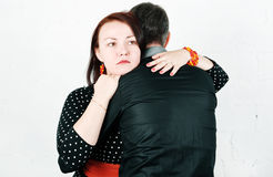 Woman comforting her man Royalty Free Stock Image