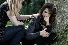 Woman comforting her mourning friend. Young women comforting her mourning friend Royalty Free Stock Image