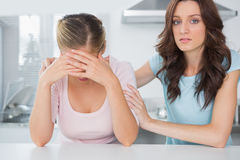 Woman comforting her overwhelmed friend Stock Photography