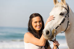 Woman comforting horse Stock Photography
