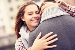 Woman comforting a man. A picture of a beautiful women comforting a man stock photos
