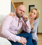 Woman comforting man Stock Photos