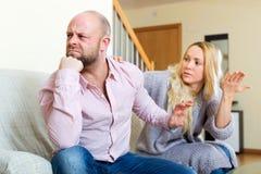 Woman comforting man Stock Photos