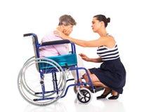 Woman comforting mother Stock Photos