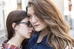 Woman comforting a sad caucasian girl Stock Photo