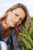 Woman with comfrey Stock Photography