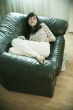Woman comfy on sofa Royalty Free Stock Images
