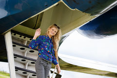 Woman coming from airplane Royalty Free Stock Photo