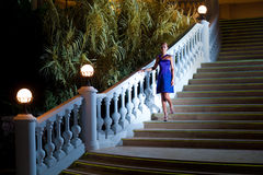 Woman coming downstairs Royalty Free Stock Images