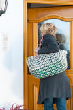 Woman coming home Stock Photo