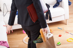 Woman coming home and see mess Stock Image
