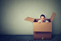 Woman coming out from a box Royalty Free Stock Photo