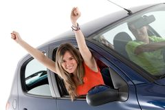 Woman coming out from a car Stock Images