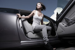 Woman coming out of her car Stock Photography