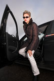 Woman coming out of her car Royalty Free Stock Photo