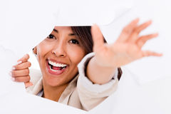 Woman coming out of a hole Stock Photography