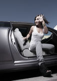 Woman Coming Out Of Her Car Stock Photos