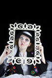 Woman coming out of picture frame Royalty Free Stock Photography