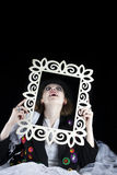 Woman coming out of picture frame Stock Photo