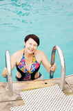 Woman is coming out from a pool Stock Photos