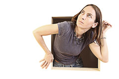 Woman coming out of a square Stock Photo