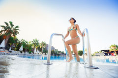 Woman coming out of the swimming pool Stock Photography