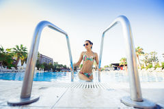 Woman coming out of the swimming pool Stock Photo