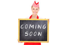Woman with a coming soon board Stock Image