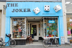 Woman coming in to The Joker toys shop in centre of Utrecht, the. Utrecht, the Netherlands - February 13, 2016: Woman coming in to The Joker toys shop in city Stock Photos