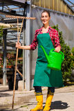 Woman commercial gardener in nursery Royalty Free Stock Photo