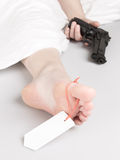 Woman committed suicide, under a sheet with a toe tag Stock Photos