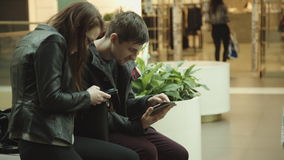 Woman communicates with man showing her something in the tablet stock video footage