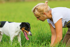 Woman is communicating with her dog Stock Image
