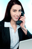 Woman communicating on phone Stock Image