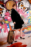 Woman commuter graffiti wall Royalty Free Stock Photo
